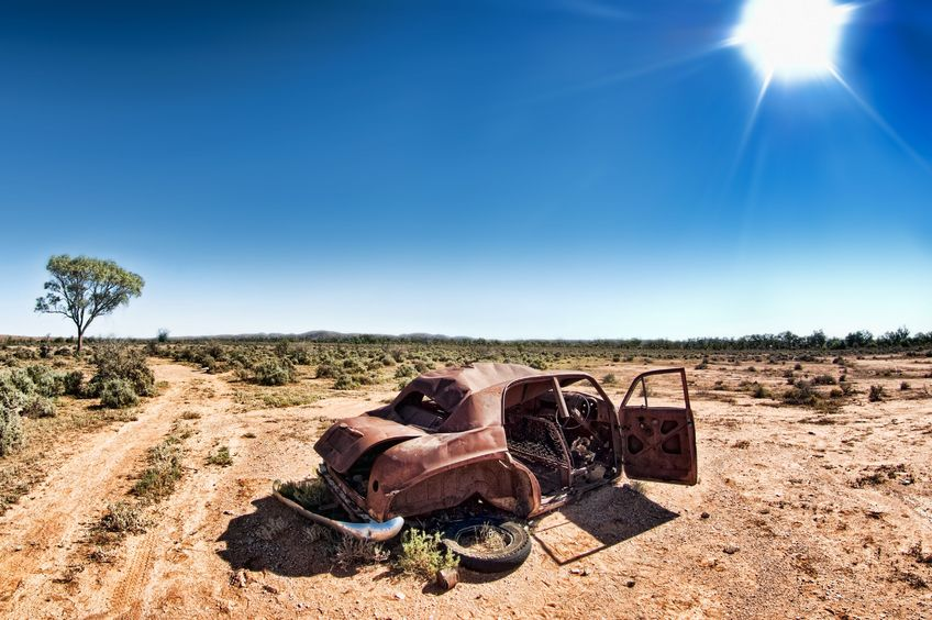 3822896 - a car rusts away under a hot sun in the desert at silverton